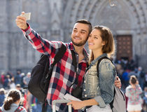 Couple with luggage taking selfie Stock Image