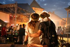 Couple. LUTSK, UKRAINE - 29 June 2008: Young couple relaxing at a open-air music festival Royalty Free Stock Image