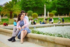 Couple in the Luxembourg garden of Paris Stock Photos