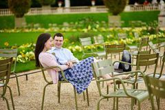 Couple in the Luxembourg garden of Paris Royalty Free Stock Photography