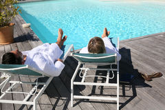 Couple in luxury resort by swimming pool Stock Photo