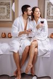 Couple in a luxury spa tasting a glass of white wine stock photos