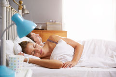 Couple Lying Asleep In Bed Together Royalty Free Stock Photography