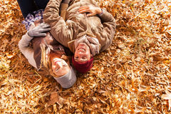 Couple lying autumn leaves Royalty Free Stock Photography