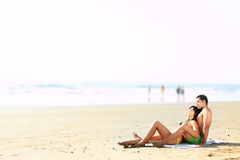 Couple lying on the beach. Portrait  of a sexy couple lying on the beach Royalty Free Stock Photography