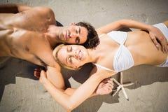 Couple lying on beach. Happy young couple lying on beach Stock Photography