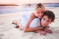 Couple lying on the beach Stock Image