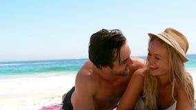 Couple lying on the beach stock video