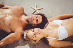 Couple lying on beach. Young couple lying on beach Royalty Free Stock Photos