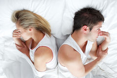 Couple lying in bed royalty free stock photography
