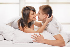 Couple lying in bed embrace Royalty Free Stock Photo