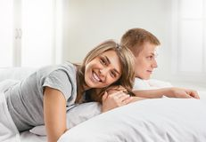Couple lying in bed Royalty Free Stock Images