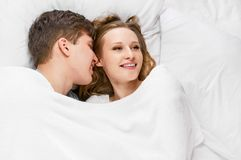 Couple lying in bed Stock Image