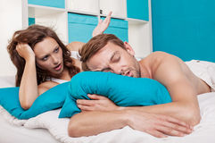 A couple lying in bed Royalty Free Stock Photos