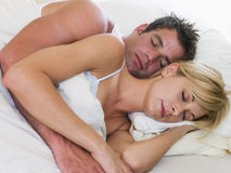 Couple lying in bed sleeping Stock Image