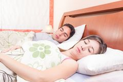 Couple lying in bed sleeping Royalty Free Stock Images