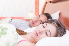 Couple lying in bed sleeping Royalty Free Stock Image
