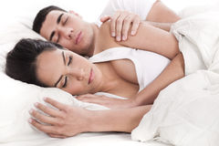 Couple lying in bed sleeping together Royalty Free Stock Photography