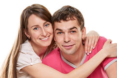 Couple lying in bed smiling Royalty Free Stock Images