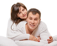 Couple lying in bed smiling Stock Photos
