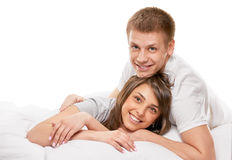Couple lying in bed smiling Stock Photo
