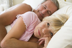 Couple lying in bed together Stock Photography