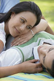 Couple Lying Blanket In Park Royalty Free Stock Photography