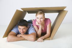 Couple lying in box Royalty Free Stock Photography