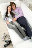 Couple lying on couch Royalty Free Stock Photo