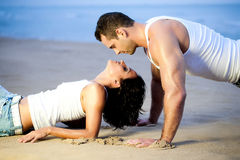 Couple lying down on beach Royalty Free Stock Image