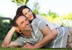 Couple lying down in the garden Royalty Free Stock Image