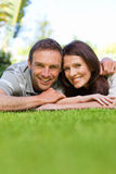 Couple lying down in the garden Stock Photos