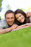Couple lying down in the garden Royalty Free Stock Images