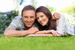 Couple lying down in the garden Stock Photo