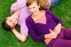 Couple lying down on grass Royalty Free Stock Images