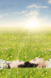 Couple lying down on the grass in springtime Royalty Free Stock Photo