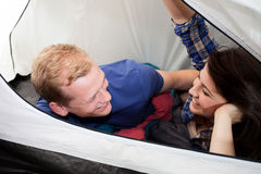 Couple lying down in the tent Royalty Free Stock Images