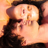 Couple lying face to face Royalty Free Stock Photos