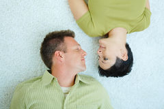 Couple lying on floor Royalty Free Stock Photo