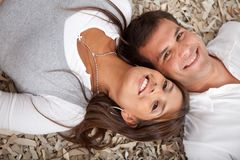 Couple lying on the floor Royalty Free Stock Images