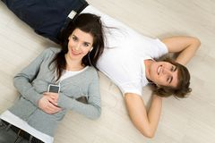 Couple lying on the floor Royalty Free Stock Image