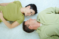 Couple lying on floor Stock Photography