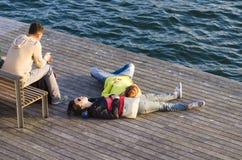 Couple lying on the floor Stock Photography