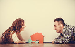 Couple lying on floor daydreaming at home Stock Photography