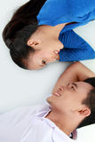 Couple lying on the floor, happy smile Stock Photography
