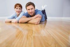 Couple lying on the floor Stock Image