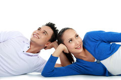Couple lying on the floor looking up to copy space stock photo