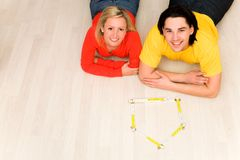 Couple lying on floor in new home Royalty Free Stock Photography