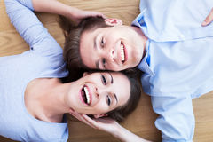 Couple lying on the floor Stock Images