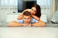Couple lying on the floor Royalty Free Stock Photos